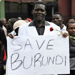 "Violence escalates ... An activist holding a placard reading ""Save Burundi"" protests in the Kenyan capital of Nairobi on December 18, 2015, against recent killings in neighbouring Burundi by government forces in a crackdown against public dissent to a controversial third-presidential term. ©AFP"
