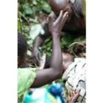 A family mourns a massacre victim in Mokoko, October 2014 © Dearbhla Glynn