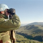 A United Nations Preventive Deployment Force (UNPREDEP) peacekeeper is monitoring the border of The former Yugoslav Republic of Macedonia in October 1998.