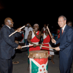 Secretary-General Ban Ki-moon beats a traditional drum with Burundian President Pierre Nkurunziza during a dinner hosted by Mr. Nkurunziza in Bujumbura, Burundi in June 2010.