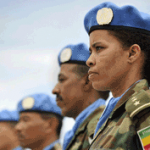 A Female Member of the Ethiopian Battalion of the United Nations Mission in Liberia (UNMIL) Joins the Military Observers in a Parade After Receiving Medals in Recognition of Their Contribution to the Mission ©UN Photo